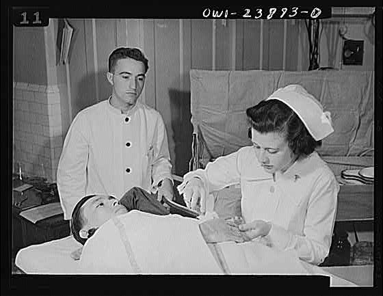 Photograph: Nurse Applying Dressing to Injured Soldier in Army Hospital