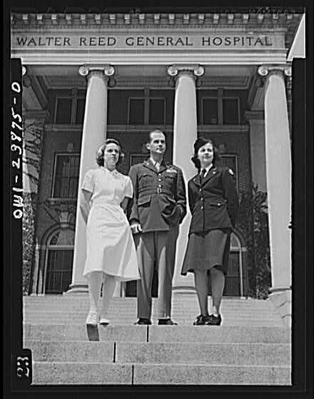 Photograph: Two Army Nurses Flank Veteran Soldier on the Steps of the Army's Walter Reed General Hospital