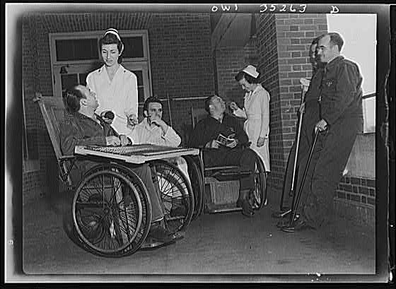 Photograph: Five Injured Soldiers and Two Nurses Conversing on a Porch of Walter Reed Hospital